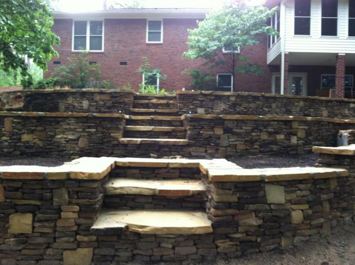 [Image: Landscape your yard with stunning stone slabs and create beautiful steps as well. ]