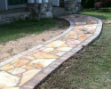 Our stonemasons  can come up with unique design for your patios and walkways in a variety of natural stone types.